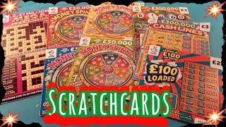 Scratchcards..MONEY SPINNER..£100 LOADED..MEGA CASHWORD..RAINBOW BINGO..WIN £50..CASH MATCH.£100,000