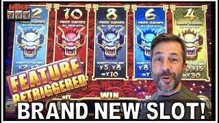 IT'S A BRAND NEW SLOT!  5 DRAGONS RISING JACKPOTS and I retriggered in the bonus!