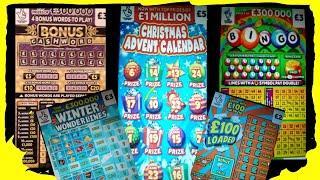 Scratchcards..CASHWORD..CHRISTMAS ADVENT CARD..WONDERLINES..£100 LOADED..RAINBOW BINGO